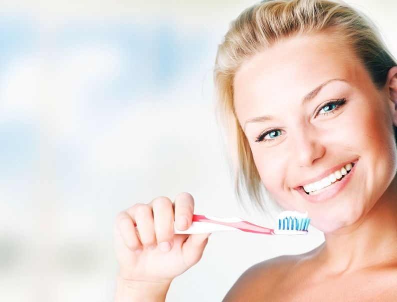 smiling toothbrush lady for appts page